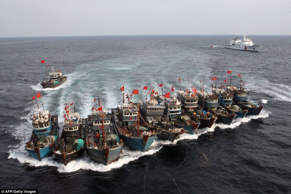 Running from the law: Chinese fishing boats tied themselves together to try and evade capture from South Korea